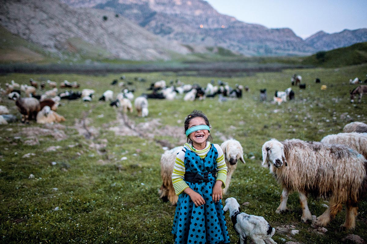 During transhumance, the Bakhtiari people, such as Mahsan and her family, camp at a different site every night for their animals to graze on fresh pastures. Near Lali, Khuzestan Province, April 2016.